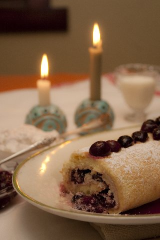 Cherry Hill Roulade with table candles photo by Christine Murphy