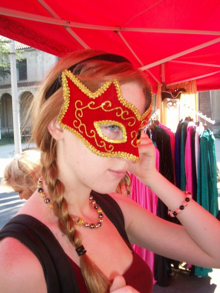 Selecting a masquerade mask at Venice Beach