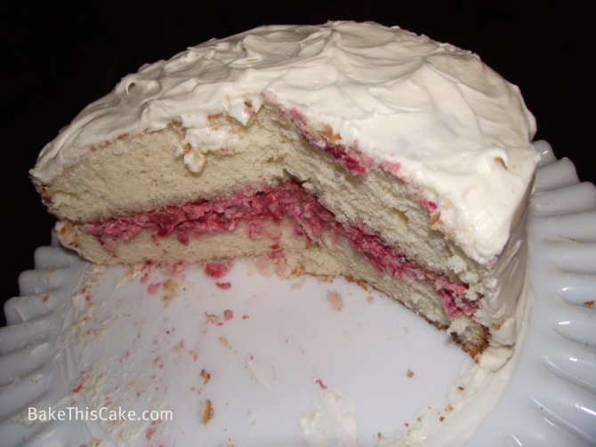 Whipped Cream Cake cutaway on milk glass platter caption ...