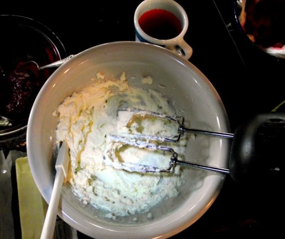 Beating cream cheese for frosting Bake This Cake recipe