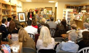 Christine speaking at book signing event Photo by John Albritton