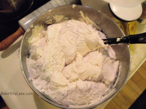 Folding flour into batter for Lady Baltimore Cake by BakeThisCake