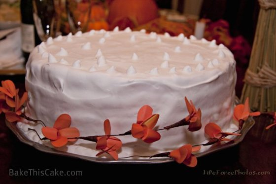 Lady Baltimore Cake closeup with orange flowers by BakeThisCake Photo by LifeForcePhotos