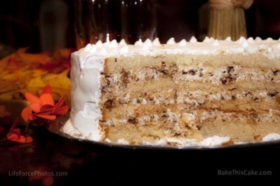Lady Baltimore Cake Cutaway shot on milk platter by BakeThisCake Photo by LifeForcePhotos