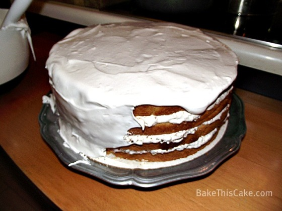 Lady Baltimore Cake with sides being frosted by BakeThisCake