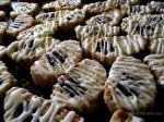 Prairie Cakes fig cookies on baking tray drizzled with Sherry Icing BakeThisCake