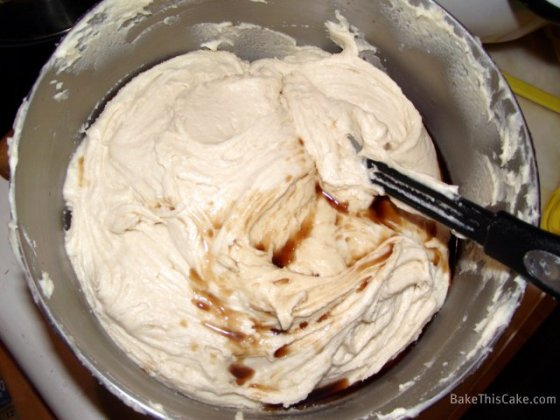 Vanilla into batter for Lady Baltimore Cake by BakeThisCake