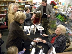 Viola Odell signing While Wandering book at book signing event Photo by John Albritton