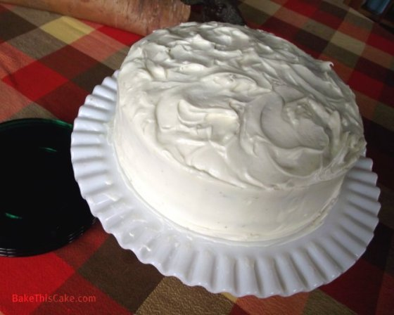 Whipped Cream Cake on milk glass plate by Bake This Cake