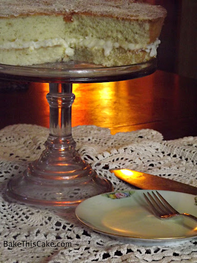 Buttermilk Cake on Dining Room Table on Glass Platter Bake This Cake