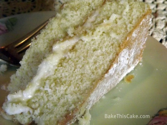 Buttermilk Cake Slice showing sprinkled top of cake slice Bake This Cake