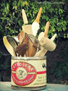 Cottolene Can filled with wooden spoons Bake This Cake