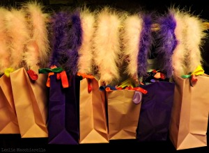Feather birthday party bags  photo by Leslie Macchiarella