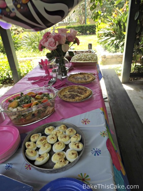 Picnic Table with Potluck Food BakeThisCake