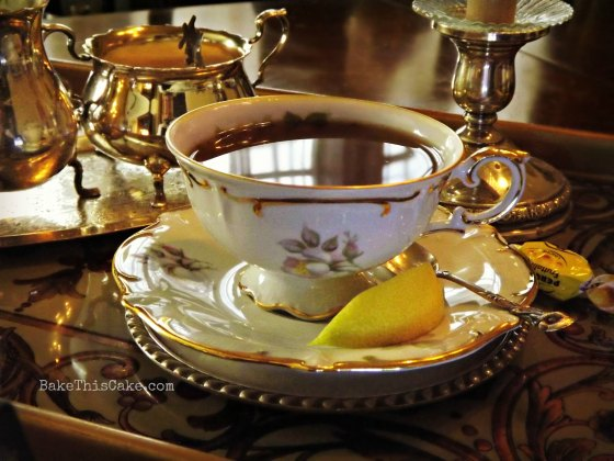 Vintage Tea Cup with Tea and Lemon Bake This Cake