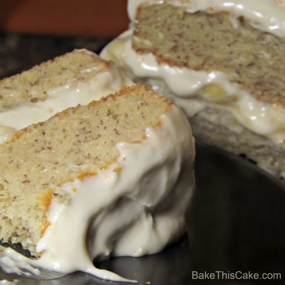 Banana Layer Cake recipe on black plate with cake in BG BakeThisCake