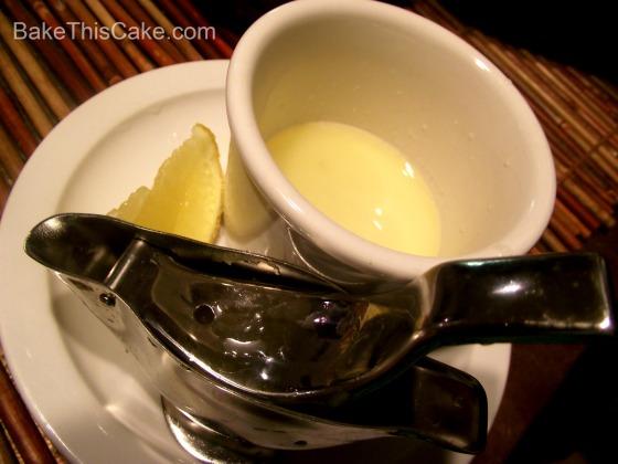 Squeezing lemon juice for Banana Frosting BakeThisCake