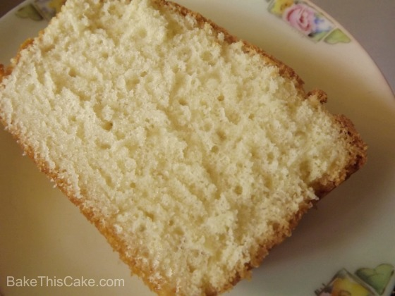 Slice of Homemade Sour Cream Pound Cake on an antique Bavarian plate Bake This Cake