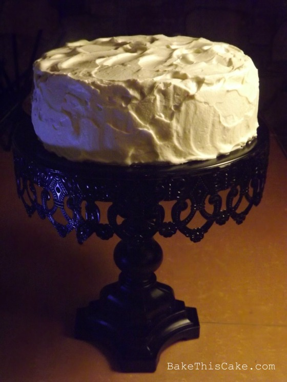 Fully Frosted Vintage Orange Lemon Cake on Black Cake Stand Bake This Cake