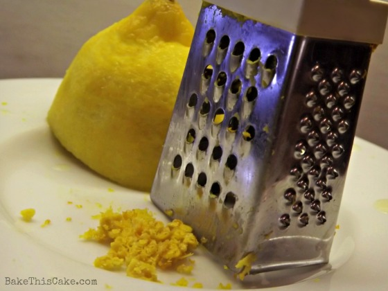 Grating lemon peel Bake This Cake