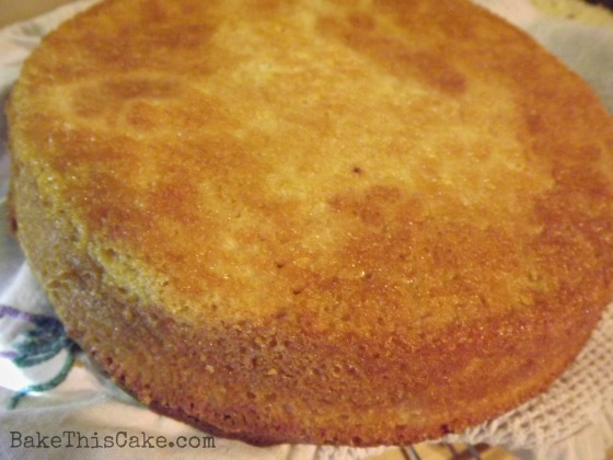 Orange Lemon Cake cooling on a towel Bake This Cake