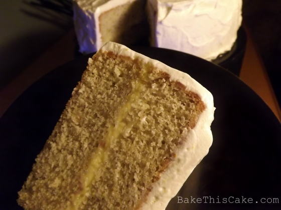Slice of Orange Lemon Cake on a black Mikasa plate Bake This Cake
