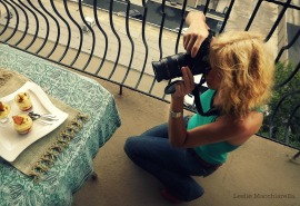 Cathy photographing for her food blog BakeThisCake