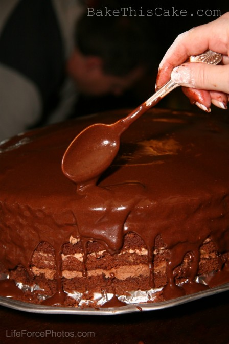 Pouring ganach on Devils Food Cake photo by LifeForcePhotos for Bake This Cake