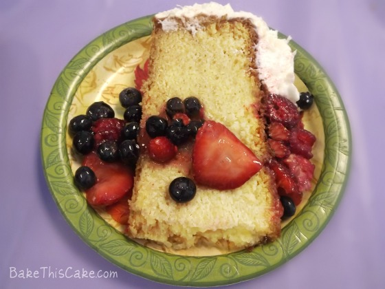 Slice of Boston Cake on a Paper Plate with Fruit and Custard Frosting BakeThisCake