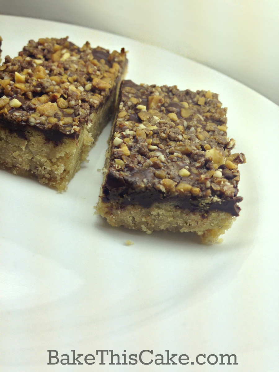 Blonde Brownies Toffee Bars on a white plate by bake this cake