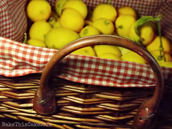 Fresh Lemons in a Vintage Basket by Bake This Cake