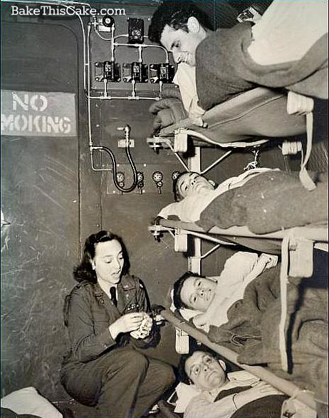 Flight Nurse assistance wounded servicemen on board WWI plane