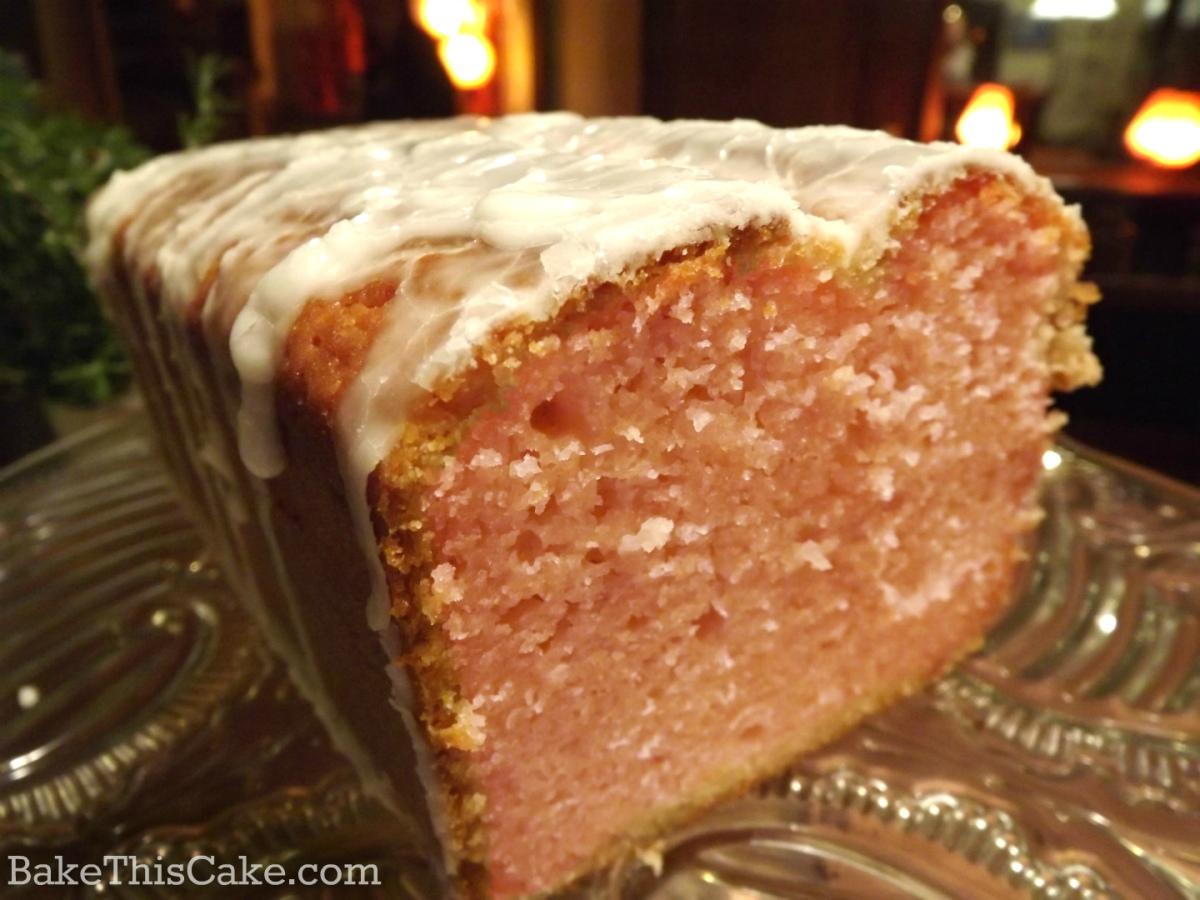 Strawberry Lemonade Pound Cake on a vintage glass platter by bakethiscake