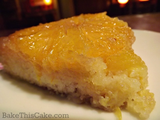 Slice of homemade vintage orange upside down cake by bake this cake