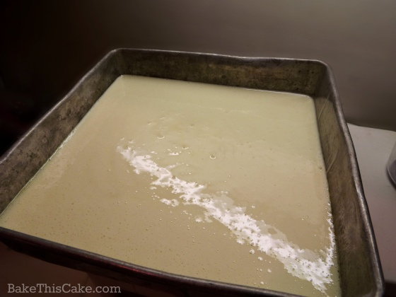 Lazy Daisy Cake batter in a brownie pan ready to bake by bake this cake