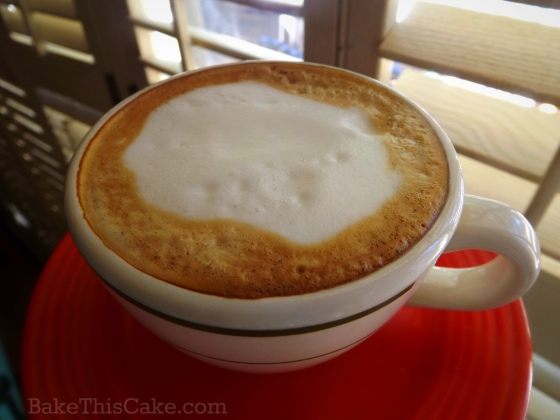 Morning cappuccino in a vintage cup and saucer by bake this cake