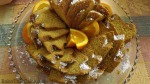Harvest Gold Pumpkin Cake with oranges sliced for Guests by bake this cake