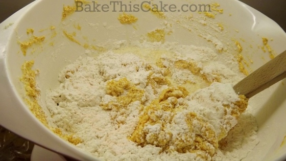Mixing dry with wet for vintage golden pumpkin cake recipe by bake this cake
