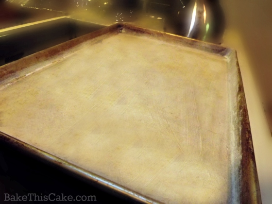 Buttered baking pan for homemade biscotti by bake this cake