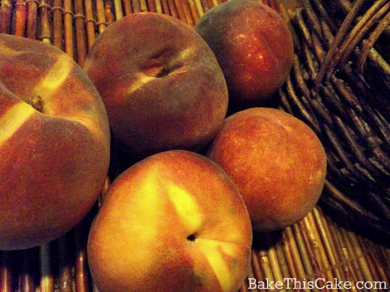 Fresh Peaches on a bamboo mat by bake this cake