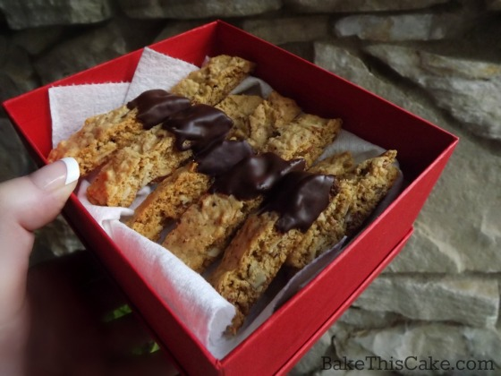homemade gift from the kitchen of chocolate dipped biscotti by bake this cake
