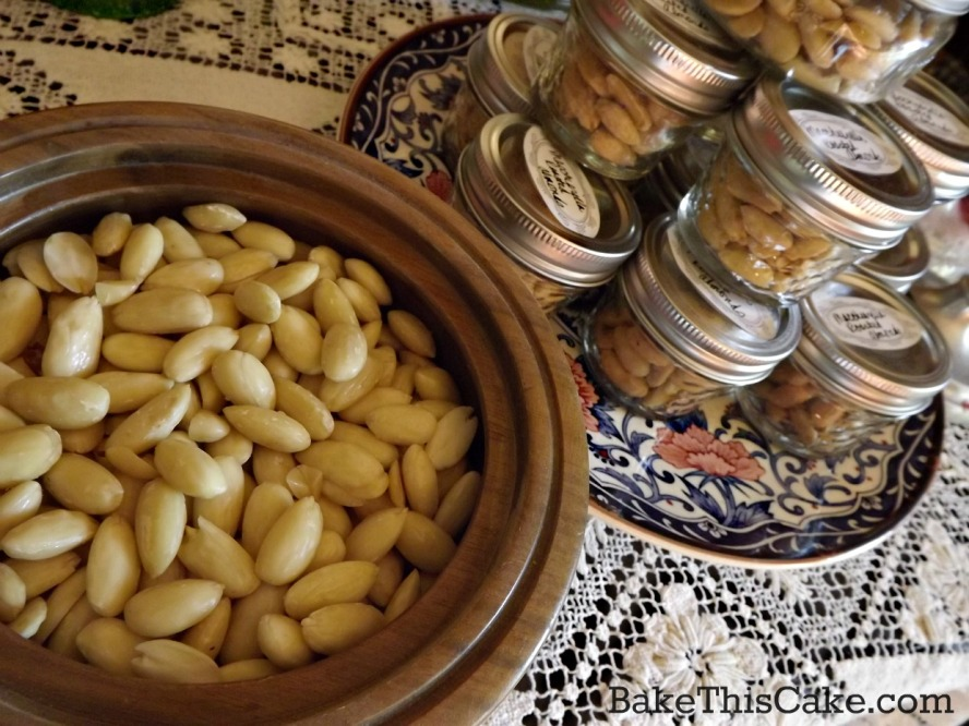 Homemade Holiday Nuts in Wooden Nut Bowl with jar gifts by bake this cake