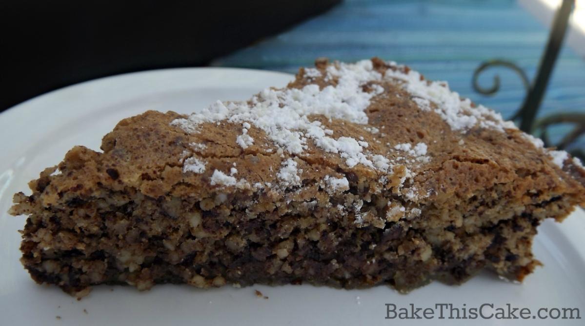 Italian Chocolate Almond Torte Caprese blue patio background by bakethiscake