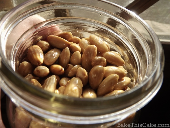 gift jar of homemade roasted almonds by bake this cake