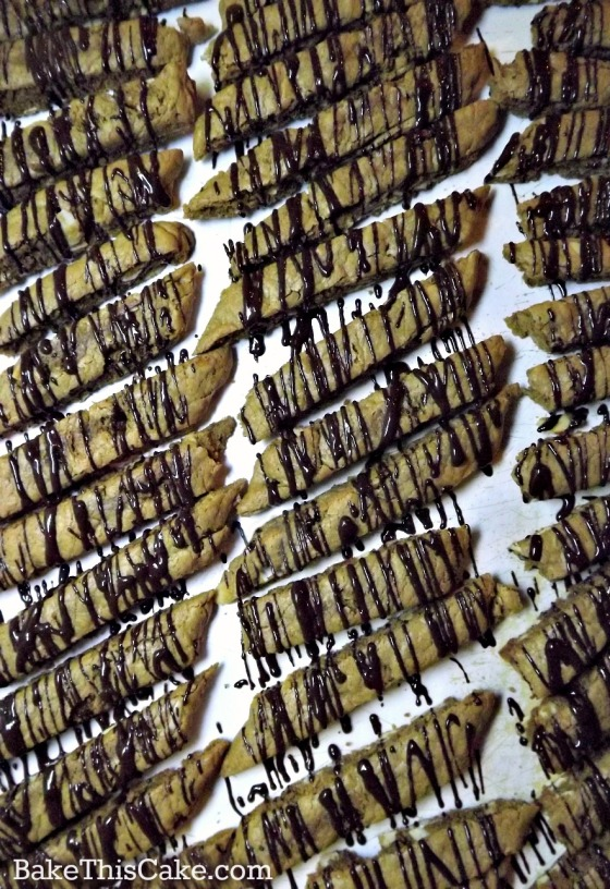 A sea of chocolate drizzled homemade biscotti by bake this cake