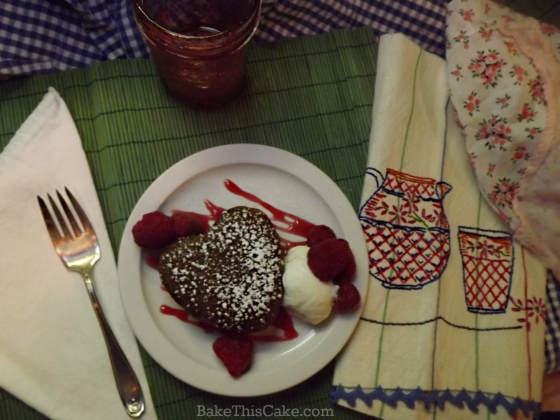 Homemade Ginger bread Cake Heart overhead with embroidered towel and apron by bake this cake