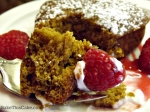 Homemade Gingerbread on a silver fork with raspberry and creme fraiche by bake this cake
