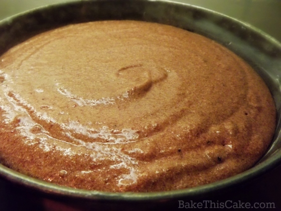 Pink batter in the pan for natural no dye red velvet cake recipe by bake this cake