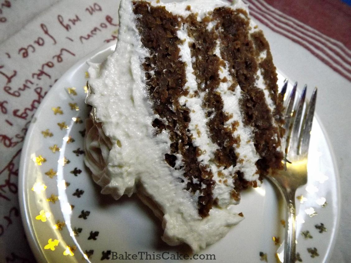 Slice of btoen red velvet cake by bake this cake