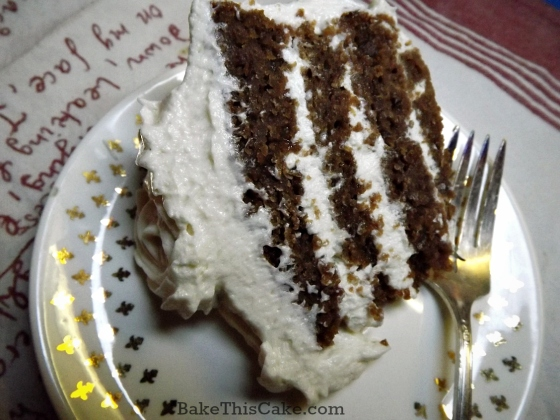 Slice of btoen red velvet cake by bake this cake